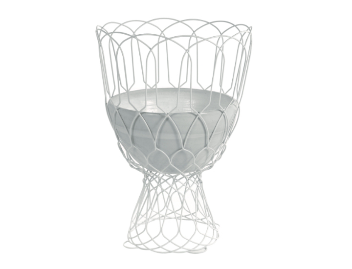Outdoor flower vase with deep white bowl and matching metal wire design around base and sides