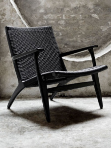Black handmade outdoor chair with woven back and seat