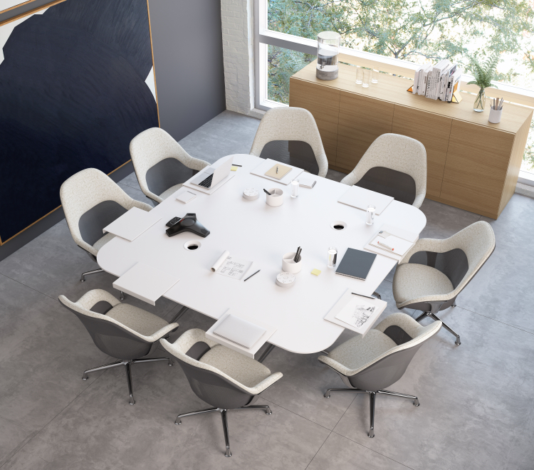 Creative collaborative space in office with white table, matching white chairs, wooden storage cabinet, and chalkboard on wall