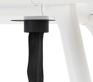 Power cable covering leading from underneath desk with protective fabric cover