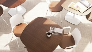 Wooden office lounge tables with rounded edges and matching white side chairs