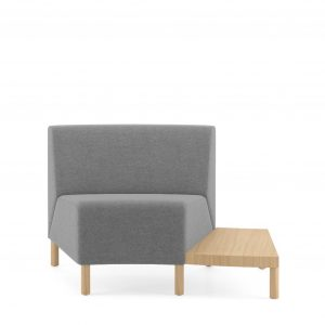 Corner lounge seat with grey upholstery and attached wooden side chair