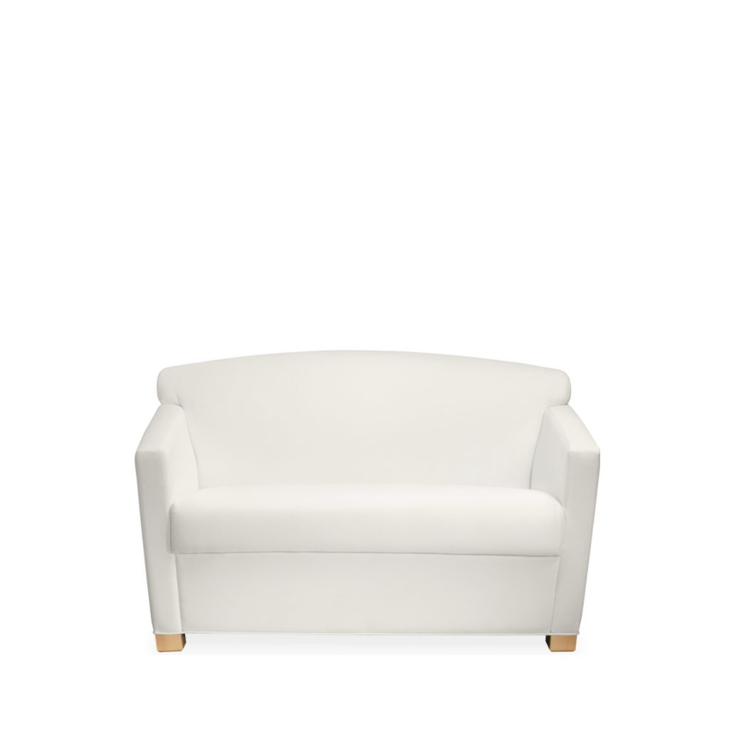 Wide, low-backed lounge seat with white upholstery, wooden legs, and sloping armrests